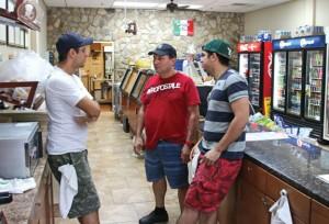 Bronx Deli owner Aldo Dasilva, center, talks with his employees Jason Machada, left, and Paulo Machada at the deli's Oxford location. Dasilva opened another location in Naugatuck in August. –LUKE MARSHALL