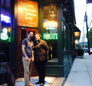 Ryan Whipple and Tara Mirto, owners of the Corner Tavern in Naugatuck, stand outside the bar on a recent weeknight. The tavern has been named best craft beer bar in Connecticut by Todd Ruggere, who runs Todd's CT Pour Tour. –RA ARCHIVE
