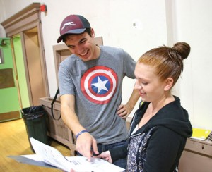 James Goggin, Jr., left, and Jean-Marie McGrath review the script for the Naugatuck Teen Theater's production of 'A Midsummer Night's Dream' Oct. 8. Goggin is directing the play and McGrath is the stage manager. –LUKE MARSHALL