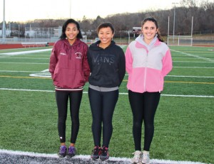 Naugatuck High seniors, from left, Harmony Sturdivant, Mercedes DeSousa and Carla Soares will lead the Greyhounds as they seek to set the pace for indoor track this season. –LUKE MARSHALL