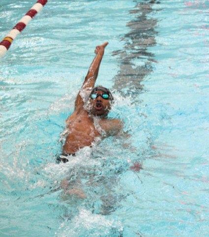 Naugatuck's Omari Solomon swims the backstroke during the 200 medley relay Feb. 20 versus Masuk in Naugatuck. Naugy won the meet, 94-74. –ELIO GUGLIOTTI