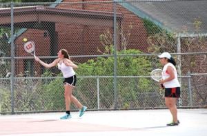 Naugatuck's Crystal Wooster, left, returns a volley alongside her partner, Karla Iglesias, during a match against Emily Negron and Heather Brown of Sacred Heart May 6 at Naugatuck High School. Wooster and Iglesias won their match, 8-6, as the Greyhounds won overall, 6-1. –LUKE MARSHALL
