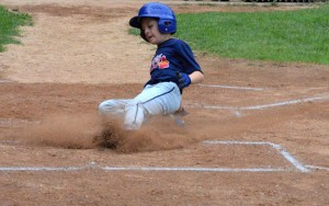 Andrew Tyska, of the Union City Braves, slides safely into home Saturday versus the Peter J. Foley Little League Giants. The Braves and the Giants played for the Naugatuck title Saturday at Foley Field. The Braves won the game, 9-1. –KEN MORSE