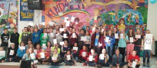 Over 50 Long River Middle School students volunteered to stay after school Nov 9 to assemble 228 care packages for veterans at the VA Hospital in West Haven. Students collected donations for the packages and each student drew a card with their own personal message of gratitude to be given to the veterans. –CONTRIBUTED