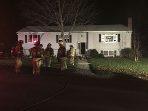 Firefighters were standing by after a kitchen fire at 55 Stone Fence Road in Naugatuck damaged the home Sunday night. -REPUBLICAN-AMERICAN