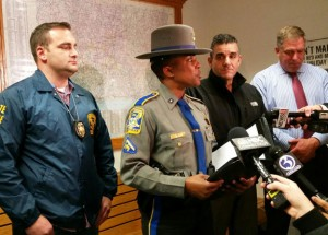 State Trooper First Class Kelly Grant, center, leads a press conference in November at Troop A in Southbury on the arrest in a murder. Grant, a Naugatuck native and current resident, has been the official spokeswoman for the Connecticut State Police since September. –REPUBLICAN-AMERICAN