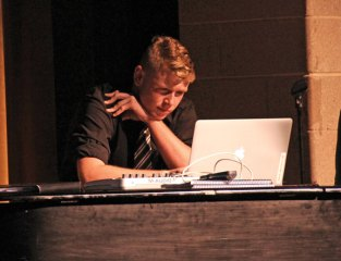 Woodland Regional High School senior David Bobbie plays a piece of music he created on GarageBand, a music creation software, for an audience Nov. 19 during the school's Fall Fine Arts Night. Students showcased their photography, painting, drawing and music during the evening. –LUKE MARSHALL