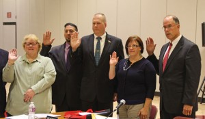 Naugatuck Board of Education members, from left, Dorothy Neth-Kunin, Jason Celozzi, Scott Slauson, Jill Mahoney and David Heller are sworn in Nov. 12 at Naugatuck High School. Board members James Scully, Diana Malone and Glenn Connan, who are not pictured, were also sworn in. The board elected Neth-Kunin as its new chair. –LUKE MARSHALL