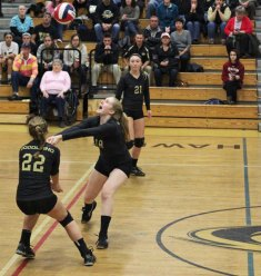 Woodland's Ruthie Costanzo (18) bumps the ball in front McKenna Cronin (22) versus Rockville during the Class M quarterfinals Friday in Beacon Falls, Woodland won, 3-0. –ELIO GUGLIOTTI