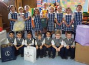 The kindergarten class at St. Francis-St. Hedwig School in Naugatuck recently collected clothes to donate to the Salvation Army shelter in Waterbury. –CONTRIBUTED