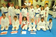 Students advanced during a junior beginners grading Nov. 19 at USA Martial Arts in Naugatuck. Pictured, front row, Ana Sales, Sazon Cermenika, Arelys Robles, Xavier Blanchet, Jiaden Dozier and Iaasac Barros-Silva; back row, Luke Reilly, Wayne Sharik, Caleb Bratchel-Rees, Lukas DeOliveira, Jarok Dauber, Caleb Gonzales, Alexis Happy and Wilmer Robles. –CONTRIBUTED