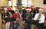 Members of the Naugatuck High School jazz band played holiday music for residents of Glendale Center in Naugatuck Dec. 11. –LUKE MARSHALL