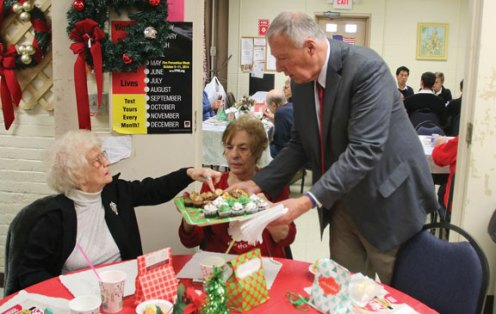 Naugatuck Mayor N. Warren 'Pete' Hess serves cupcakes and cookies to Darygh Van, right, and Jan Woodfield Dec. 9 during the Naugatuck Senior Center's annual Christmas luncheon. Attendees were served lunch by the mayor and members of U.S. Army Recruiting Station in Waterbury. Members of the Novitiate and College of Humanities of the Legionaries of Christ sung Christmas carols, as well. –LUKE MARSHALL