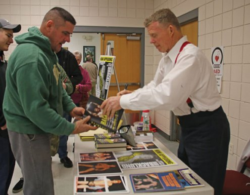 Former WWE champion turned author discusses book Former World Wrestling Entertainment wrestler Bob Backlund, right, signs a copy of his book, 'Backlund: From All-American Boy to Professional Wrestling's World Champion,' for Prospect resident Mike McAllen Nov. 24 at the Prospect firehouse. Backlund discussed his book during an author talk hosted by the Prospect Library. –LUKE MARSHALL