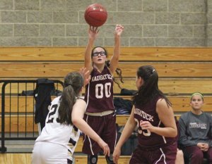 Naugatuck's Jackie Aronin (00) puts up a shot Dec. 18 versus Woodland in Beacon Falls. Woodland won the game, 41-27. –ELIO GUGLIOTTI