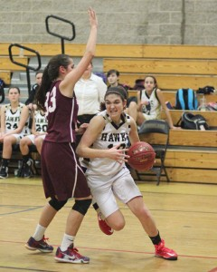 Woodland's Carla Piccolo (10) drives past Naugatuck's Molly Kennedy (33) Dec. 18 in Beacon Falls. Woodland won the game, 41-27. –ELIO GUGLIOTTI