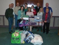 Brown Roofing Co. of Naugatuck, a member of Profnet of Waterbury, Inc., recently held a 'Bedding Bonanza' to collect blankets, sheets and comforters for the nonprofit Acts 4 Ministry in Waterbury. Pictured, front row from left, Profnet member Sandy Marino, Executive Director of Acts 4 Ministry Sarah Elizabeth Carabetta, Profnet members Margie Lindsey, Barbara Rompre, Barbara Branagan-Mitchell; back row from left, Profnet members Bruce Brayton, Scott Little, Pam Davis of Brown Roofing Co., Mike Wilkowski and John Leach. –CONTRIBUTED