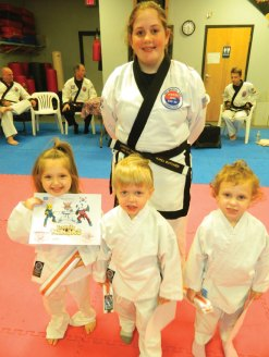 'Little Ninja' students Caoilainn Gallagher, Bently Charest and Riley Cook were promoted recently during a grading at USA Martial Arts in Naugatuck. Pictured with the students is instructor Karli Butcher. –CONTRIBUTED