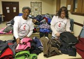 Naugatuck United Methodist Church Mission Chairman Ethel Grant, left, and Preschool Chairman Dawn Mudry straighten out coats during the church's coat giveaway event on Jan. 18 at the church. The church collected coats, hats and scarves, and donated the outerwear to anyone who stopped in the church. The program, which was new this year, was hosted by the church's preschool and mission committees. –LUKE MARSHALL