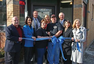 Stonehouse Baked Goods owner John Cummings and his wife, Barbara Cummings, center, cut a ribbon to mark the grand opening of their business on North Main Street in Naugatuck Jan. 7 while surrounded by local and state dignitaries. In attendance were, front row from left, Burgess Rocky Vitale, Waterbury Chamber of Commerce President and CEO Lynn Ward, state Rep. Rosa Rebimbas (R-70), state Sen. Joan Harley (D-15); back row from left, Naugatuck Mayor N. Warren 'Pete' Hess, Burgess Laurie Taf Jackson, and Naugatuck Economic Development Corporation President and CEO Ron Pugliese. –LUKE MARSHALL