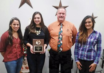 The Connecticut Board of Volleyball Officials presented the Naugatuck High School volleyball team with the 2015 Sportsmanship Award Dec. 17 at the school. The team earned the award for sportsmanship displayed by the players, managers and coaches throughout the 2015 season. Pictured, from left, captain Jenna Massicotte, captain Ally Mezzo, coach Kevin Wesche and captain Alexa Blazas. -CONTRIBUTED