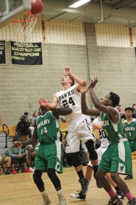 Woodland's Nick Denze (24) battles for a rebound between Wilby's Jerquan Smalls (14) and Darrien Bell (5) Monday night in Beacon Falls. Wilby won the game, 88-48. –ELIO GUGLIOTTI