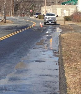 A water main on Railroad Avenue in Beacon Falls broke Tuesday. –CONTRIBUTED