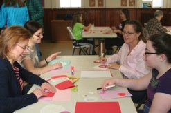 Naugatuck residents Carolyn Burger and Lauren Burger, left, and Sharon Hurlbut and Londyn Burger participate in the Trumbull-Porter Chapter Daughters of the American Revolution's ninth annual Valentines for Veterans Workshop at Grace Lutheran Church in Naugatuck Jan. 30. In total, 250 valentines were made for Connecticut veterans. Most of the cards will go to veterans at the Newington, Rocky Hill and West Haven veterans hospitals, while some will be sent to a unit of deployed troops. Participants also donated over $250 worth of individually wrapped candy to give to veterans. Members of the chapter were also awarded a Certificate of Appreciation for their 'Continued Support of our Veterans' by the Ladies Auxiliary Post 7330. –CONTRIBUTED
