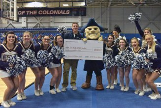 Western Connecticut State University student William Alfiere, of Beacon Falls, sank a half-court basketball shot Jan. 27 at halftime of the Colonials basketball game to win $5,000 toward his tuition. 'I didn't expect to make it. You throw a shot up like that every now and then for fun, but you never expect it to go in. … But as soon as I shot it, I knew it was going to go in. It's one of those feelings you have as a basketball player,' said Alfiere, who was a captain of the Woodland Regional High School boys basketball team as a senior, in a press release. Alfiere is pictured with the university's mascot, Colonial Chuck, and members of the WCSU cheerleading squad. -PEGGY STEWART