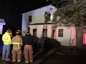 Firefighters look for hot spots in the attic at 1192 New Haven Road where a fire broke out Sunday night. Six people were inside the house when a fire started in the kitchen. Passers-by helped a senior citizen out of the house. Nobody was injured. -REPUBLICAN-AMERICAN