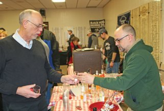Jack Lewis, left, of Naugatuck, takes a sample provided by Keith Pinto of Fine Wines and Liquors in Naugatuck Feb. 13 during the Naugatuck Historical Society's annual Savor CT at the Naugatuck Elks Lodge. The event featured samples of food and alcohol made in Connecticut. About 190 tickets were sold for the event, which was more than double last year's ticket sales, according to historical society Treasurer Wendy Murphy. –LUKE MARSHALL