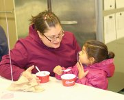 Lisa Hossein, left, talks with her daughter, Ava, 3, Feb. 4 at Western Elementary School during an ice cream social to raise money for second-grader Olivia Thompson, who had underwent heart transplant surgery in November. The ice cream social drew over 200 people and raised more than $400 for Thompson and her family, Western Principal Brenda Goodrich said. –LUKE MARSHALL