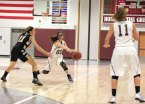 Naugatuck's Jackie Aronin (00) passes the ball to Mia Rotatori (11) as Woodland's Eliza Smith (11) defends Feb. 12 in Naugatuck. Woodland won the game, 40-31. –ELIO GUGLIOTTI
