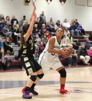 Naugatuck's Alexis Woods (51) looks to the basket after pulling down a rebound as Woodland's Jenna Pannone (25) defends Feb. 12 in Naugatuck. Woodland won the game, 40-31. –ELIO GUGLIOTTI