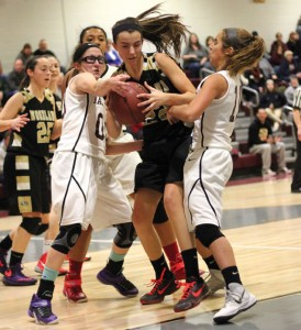 Woodland's Morina Bojka (22) pulls down a rebound between Naugatuck's Jackie Aronin (00) and Mia Rotatori (11) Feb. 12 in Naugatuck. Woodland won the game, 40-31. –ELIO GUGLIOTTI