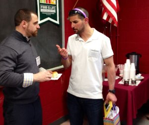 Brian Mariano, left, congratulates Naugatuck High School physical education teacher Tony Loomis on being named national PE teacher of the year in 2014. Mariano is the interim athletic director at the high school. –RA ARCHIVE