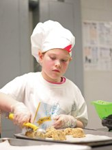 Western Elementary School fourth-grader Lily Kardos places scoops of her tropical oatmeal breakfast cookies mix on a baking sheet during the Sodexo Future Chef competition March 9 at Naugatuck High School. –ELIO GUGLIOTTI