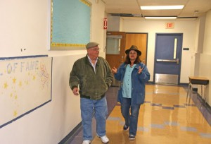 Prospect residents Terry Dominy, left, and Ann Stein tour the former Community School in Prospect Monday before a town meeting to vote on the purchase of the school. Residents unanimously approved buying the school for $873,000 from the Region 16 school district, which oversees schools in Beacon Falls and Prospect. The sale of the school must now be approved at a district meeting. –LUKE MARSHALL