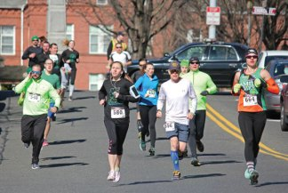 Runners in a 10K race make their way down Maple Street in Naugatuck March 19 during the sixth annual Ion Bank St. Patrick's Day Road Race and Festival. Nearly 700 people participated in the event, which also featured a 5K and walk. The event is a fundraiser for the Naugatuck Education Fundraiser, which raises money to support educational programs in Naugatuck schools that are not funded through the annual budget. The event netted about $30,000 for the foundation, said Matt Fortney, immediate past president of the NEF. That included about $14,000 in sponsorships from a number of donors and registration fees. –ELIO GUGLIOTTI