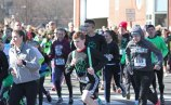 Runners in a 5K race turn the corner from Old Firehouse Road on to Maple Street in Naugatuck March 19 during the sixth annual Ion Bank St. Patrick's Day Road Race and Festival. Nearly 700 people participated in the event, which also featured a 10K and walk. The event is a fundraiser for the Naugatuck Education Fundraiser, which raises money to support educational programs in Naugatuck schools that are not funded through the annual budget. The event netted about $30,000 for the foundation, said Matt Fortney, immediate past president of the NEF. That included about $14,000 in sponsorships from a number of donors and registration fees. –ELIO GUGLIOTTI