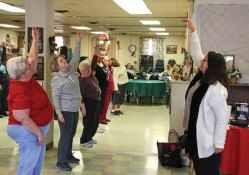 Connecticut Dance Theater Director Donna Bonasera, right, leads seniors from Naugatuck and Watertown in warm-ups during a dance lesson March 3 at the Naugatuck Senior Center as part of the Dance for the Love of It, Dance for the Health of It program. The year-long program takes place at Watertown's Falls Avenue Senior Center on Mondays and the Naugatuck Senior Center on Thursdays. The program was funded by a grant from the Connecticut Community Foundation. –LUKE MARSHALL