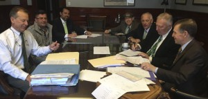 The borough closed Thursday a deal with restauranteur Jim Perzhilla and local attorney Carlos Santos, who bought the former train station in Naugatuck with intentions of turning it into a restaurant. In the photo at the closing are, from left, going around the table, borough attorney Edward 'Ned' Fitzpatrick, Perzhilla, Santos, realtor Tom Hill III, Naugatuck Economic Development Corporation President and CEO Ron Pugliese, Mayor N. Warren 'Pete' Hess and attorney Kevin McSherry. -REPUBLICAN-AMERICAN