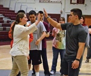 Naugatuck High School senior Caitlyn Armentano, left, high fives fellow student Brandon Papp during a recent Unified basketball practice at the school. –KEN MORSE