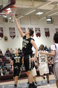 Woodland's Jon Scirpo (20) lays in a basket versus Naugatuck Feb. 25 in Naugatuck. Naugatuck won the game, 63-26. –ELIO GUGLIOTTI