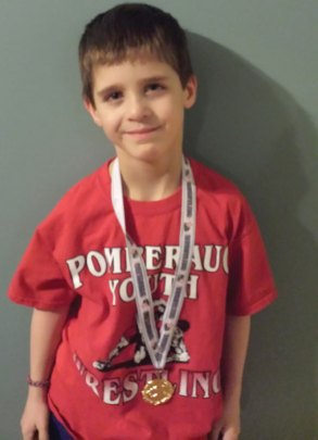 Mason Conklin, of Naugatuck, came in first in his bracket at a beginners wrestling tournament in Southington on Jan. 31. –CONTRIBUTED
