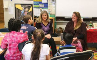 Authors Stephanie Robinson, left, and Jessica Haight talk with members of a fourth-grade book club at Hop Brook Elementary School in Naugatuck March 28. The club, which meets on Tuesdays and Thursdays, recently finished reading Robinson and Haight's book, 'The Secret Files of Fairday Morrow.' In addition to talking with the book club, Robinson and Haight talked with students in Lynn Meyers' fourth-grade class, who had read the book as well. –LUKE MARSHALL