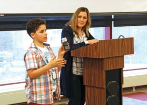 Hillside Intermediate School sixth-grader Jordan Chouinard, left, explains how Cubelets, modular robotic blocks, work as Hillside instructional coach Alyce Misuraca looks on April 7 during the Naugatuck Education Foundation's grant awards ceremony at Naugatuck High School. Hillside received a $1,812 grant to start a T.E.C.H. Club at the school that will feature the Cubelets. –LUKE MARSHALL