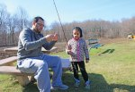 Destinee Fata, 5, of Prospect, gets help fixing her fishing pole from her father, Steven Fata, during the Prospect Parks and Recreation's 9th Annual Fishing Derby at McGrath Park April 16. –LUKE MARSHALL