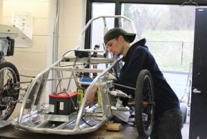 Woodland Regional High School senior Drew Korzon works on wiring an electric car April 7 during the manufacturing class at the school in Beacon Falls. The manufacturing class is building the car for the Connecticut Electrathon, a race that is May 6 at Lime Rock Park. –ELIO GUGLIOTTI