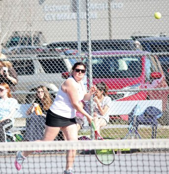 Woodland's Katie Rioux serves during a doubles match with her partner, Paige Gainey, versus Naugatuck's Patricia Escaleira and Lori Dietz April 15 in Naugatuck. –ELIO GUGLIOTTI